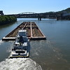 A very large spoil barge passing under the Smithfield Bridge on the Monongahela River.