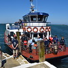 """Travel Trident caramaran ferry """"Herm Trident V"""" at the Rosaire Steps on Herm island with a shuttle from Guernsey."""