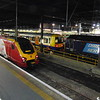 A Virgin Trains Class 221 Voyager at London Euston on the 22:30 to Birmingham New Street with a London Overground Class 378 Electrostar and DRS Class 57 no. 57304.