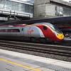 """Virgin Trains Class 390 Pendolino no. 390128 """"City of Preston"""" at Stafford on a Liverpool service."""