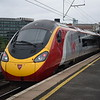 Virgin Trains Class 390 Pendolino no. 390118 unusually passing through Platform 14 at Manchester Piccadilly.