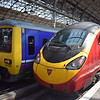 Northern Class 323 no. 323224 at Manchester Piccadilly next to Virgin Trains Class 390 Pendolino no. 390006, which had just arrived from Euston.