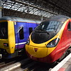 Virgin Trains Class 390 Pendolino no. 390010 at Manchester Piccadilly with the 14:15 to Euston, next to Northern Class 323 no. 323236.