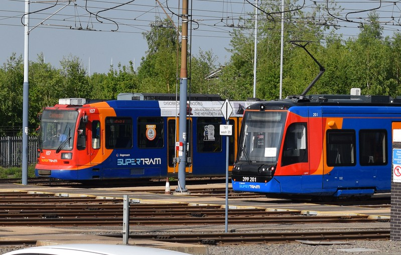 Brand new Class 399 Vossloh Citylink tram-train no. 399201 (201) with Siemens-Duewag Supertram no. 107 at the Sheffield Supertram Nunnery Square depot.
