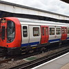 A train of London Underground S7 Stock led by 21532 at Wimbledon on a District Line service to Tower Hill.