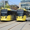 Manchester Metrolink Bombardier M5000 trams nos. 3045 and 3066 at St Peters Square on Etihad Campus and East Didsbury services respectively.