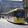 Manchester Metrolink Bombardier M5000 tram no. 3074 leaving Exchange Square on a Shaw and Crompton service.
