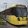 Manchester Metrolink Bombardier Flexity M5000 tram no. 3069 leaving Wythenshawe town centre on an airport service.