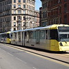 Manchester Metrolink Bombardier M5000 tram no. 3047 passing the Arndale on a Bury service.
