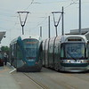 Nottingham Express Transit Alstom Citadis and Bombardier Incentro trams pass at Nottingham Station.