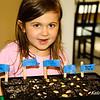 Abby planting pumpkins
