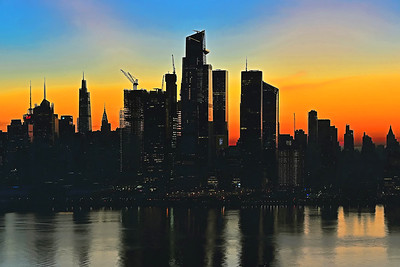 Sunrise Sky and NYC Silhouette
