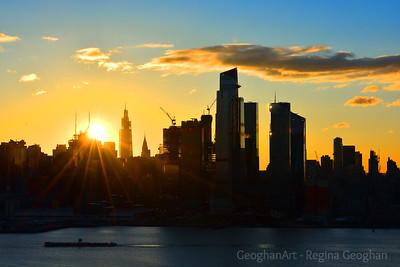 New York Skyline and Rising Sun