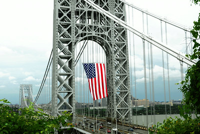 Day 184: American Flag-GW Bridge - July 4.  Happy July 4th to all of you USA Smuggers.   Raining here but did get some shots of the bridge and the flag this morning while the skies were somewhat clear.  Doesn't look too good for fireworks photos though tonight.