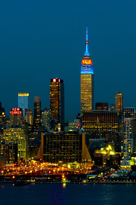 Day 090:- NYSkyine-NYMetsColors - March 31.  The March lions and lambs have been battling it out this month with the lions wiinning.  But with the NY Mets opening day today - it is certain that spring is here - I think.  The Empire State Building lit in honor or the team's opening day.
