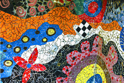 Day 283: Abstract Tile Art - Oct 14. A very small section of an outside wall that is covered with beautiful tile art at the home and studio of artist Ricky Boscarino in New Jersey. The entire house and outbuildings and yard are filled and covered with his art, collectibles and sculptures and displays made from various collections of discarded objects such as blue bottles, bowling balls, sports trophies. The artist holds an open house about twice a year for visitors to view the house and art.