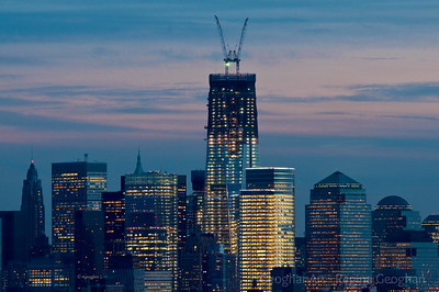 Day 20: Lower Manhattan WTC1 at Sundown - January 20, 2012.  Posting two very different images today.  For those who asked for updates of the WTC1 construction status, the steel construction has reached past the 91st floor and is expected to top out at the 105th floor in April.  The glass facade has been installed up to the 66th floor.