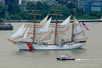 Day145: US Coast Guard's Eagle as she leads the parage of military vesselsles up the Hudson River yesterday for Fleet Week - May 24, 2012.  It was quite a wonderful sight to see with military ships and planes as well as tall ships participating in the event. Sadly for most of the event the skys were dark and cloudy with a lot of mist in the air making  not very good situation for photography of the ships.
