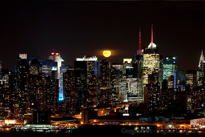 Day 69: Moonrise over Manhattan - March 8, 2012.  One more image for today.  The full moon showed its face over the Manhattan skyline for all of about three minutes before climbing under the clouds.