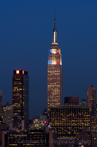 Day 312: Empire State Building Election Day Colors - Nov 6.  The Empire State Building is sporting a new look tonight for Election Day.   The ESB upgraded the lighting system just recently and is apparently trying out some new options for lighting schemes.  On a different note, it is clear that folks have been able to gas up their cars and get back on the road again.  I live a short distance from the Lincoln Tunnel and tonight the traffic has been jammed in all directions as far as the eye can see - at an almost standstill - for hours now.  I wonder how many of those commuters stuck in this traffic had planned to vote when they returned home and won't get home in time to do so because of the traffic jam.