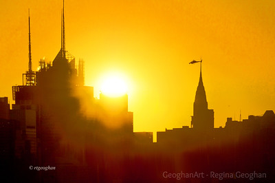 Day 286: NY Skyline Sunrise - Oct 12. Sunrise over Manhattan. It is getting to one of the few times during a year where the sunrise is within the frame along with the Chrysler Building and soon the Empire State Building from my vantage point. So I'm looking forward over the next two months to getting lots of sunrise photos. Camera settings to keep sunflare effect as that is how my eye saw it.
