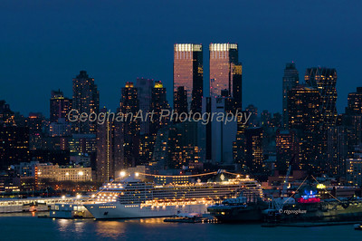 Day 113: NY Skyline Night - April 24.   A cold, damp, drizzly day yesterday but a bit of color as darkness fell and sundown light touched on the NY skyline Time Warner towers and the cruise ship MSC Poesia brightly lit as she prepared for departure.