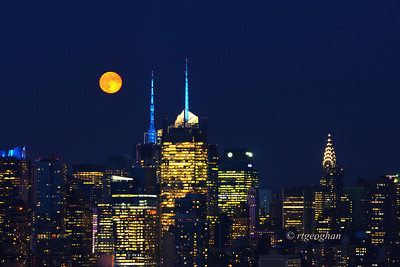 Day 231: Moonrise over Manhattan - August 22. Version 2- A stunning orange colored moonrise over midtown Manhattan last night