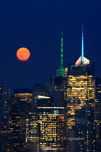 Day 231: Moonrise over Manhattan - August 22. A stunning orange colored moonrise over midtown Manhattan last night.