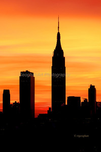 Day 26: NY Skyline Sunrise - Jan 26, 2013.  Empire State Buidling silhouetted against the sunrise color behind the New York Skyline.
