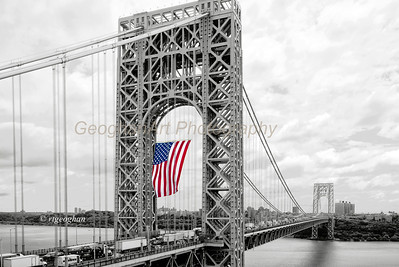 Day 163: GWBridge Flag Day 2013 - June 15.  There is something renewing and reinforcing for me when I see this giant flag blowing in the wind on the GW Bridge, so I try to get there once or twice a year on a day that it is flying. You can get a sense of the size of the flag by looking at the traffic below.  Yesterday it was on display for Flag Day.