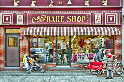Day 61: Carlos Bakery Hoboken NJ - Mar 2.   For any fans of the Cake Boss show.  Another cloudy, dark day yesterday.  Check this image in large size - it is cluttered due to window glare but at the same time it is a good representation of the location.  You can see a hint of the lines of people inside the shop but also the reflection of the cars lined up outside the shop.