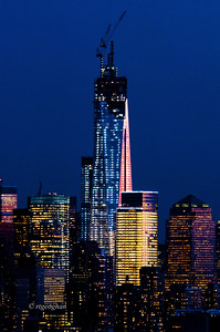 Day 65: NYC One World Trade Center - Mar 6.  The last rays of sundown light and twilight blue of the sky reflected in the buildings of lower Manhattan last night.  It has been a while since I've posted an update on the construction of One World Trade Center,  The spire will be constructed of 18 steel parts, 12 of which have been installed.  The schedule called for the spire to be completed by end of March, but I haven't seen any updates to confirm that.