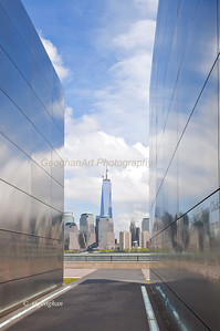 Day 126: OneWorldTradeCtr-EmptySky - May 8.  Last week the final metal pieces were put in place for the spire of One World Trade Center.  Decided yesterday to take photos of the building from Liberty State Park.  Did get some close up of the building but decided to post this one with it as seen through the 9/11 Empty Sky Memorial.