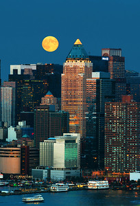 Day 259: NYSkylilne Harvest Moon - September 20.  A beautiful Harvest moon rising above midtown Manhattan last night just after sundown.. The building with the triangular top is One Worldwide Plaza at 50th street.