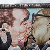 """Fraternal Kiss"" and people at the East Side Gallery in Berlin"