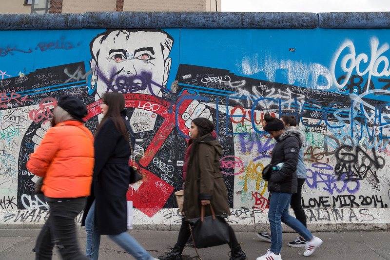 Graffiti and people at the East Side Gallery in Berlin