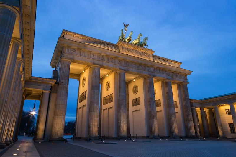 Lit Brandenburg Gate in Berlin at dusk