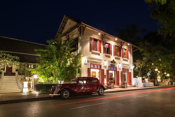 Car on an idyllic street in Luang Prabang at night