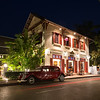 Car on an idyllic street in Luang Prabang at night