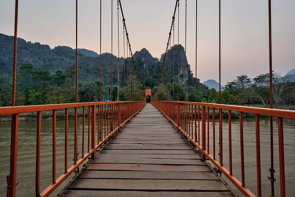 Suspension bridge and mountainous landscape in Vang Vieng