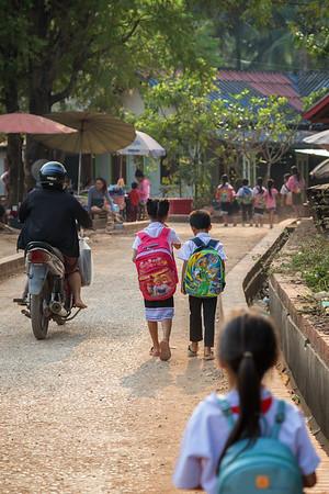 Schoolchildren walking on a street in Luang Prabang