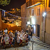 People dining alfresco in downtown Lisbon at dusk