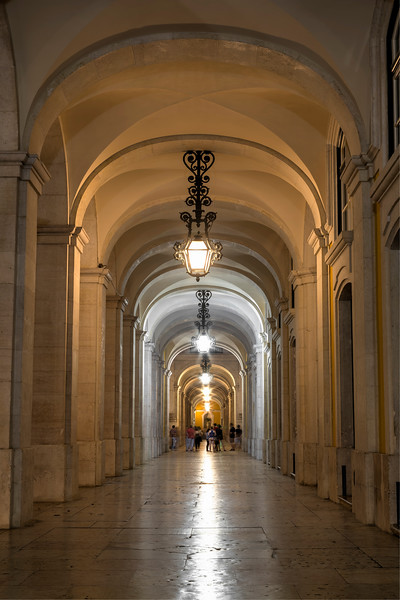 Arched and lit passageway in Lisbon at dusk