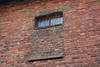 Window on the top floor partialy bricked over, it was high enough in the room to prevent looking down