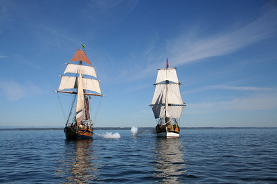 "Lady Washington and Hawaiian Chieftain fire on one another during a mock sea ""battle"". Photo by Ron Arel / Coastal Images."
