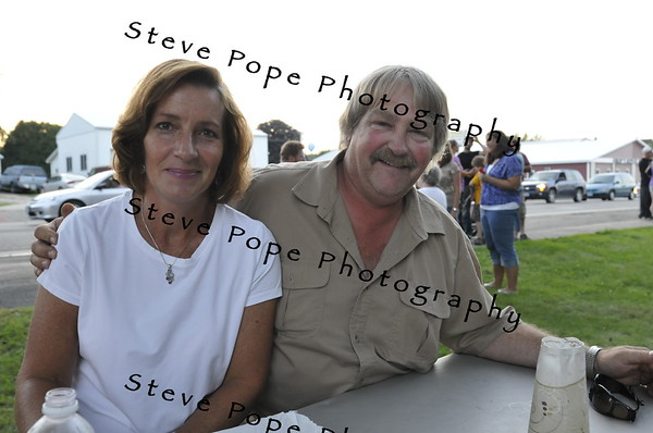 First Lady of Iowa Mari Culver mugs for a photo with Steve Duenow after the 2010 Bratwurst Day parade, Saturday July 31, 2010 in Stacyville, Iowa. Steve Pope/Photo