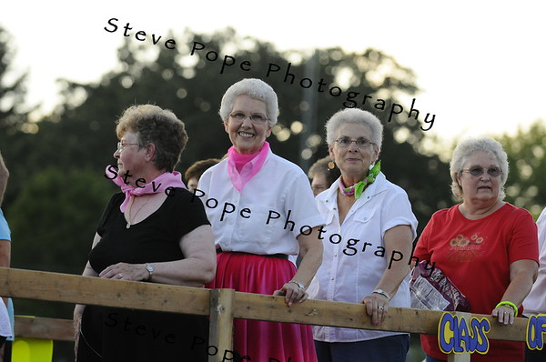 Sue Wageman and fellow classmates celebrate their reuinon atop a float in the 2010 Bratwurst Day parade, Saturday July 31, 2010 in Stacyville, Iowa. Steve Pope/Photo
