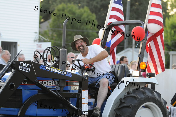 Phil Brumm is all smiles atop his entry in the 2010 Bratwurst Day parade, Saturday July 31, 2010 in Stacyville, Iowa. Steve Pope/Photo