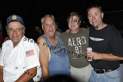 Harry May, Herm Koenigs, Jo Michaels and Denny May (left to right) gather for a photo in the beer garden of the 2010 Bratwurst Day celebration, Saturday July 31, 2010 in Stacyville, Iowa. Steve Pope/Photo