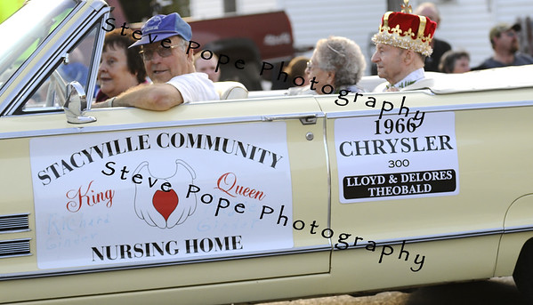 Lloyd Theobald driving a float in the 2010 Bratwurst Day parade, Saturday July 31, 2010 in Stacyville, Iowa. Steve Pope/Photo